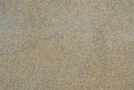stone wash: Pebble Wash finish with rough texture surface of exposed aggregate finish. Ground stone washed floor, made of small sand stone in light brown color Stock Photo