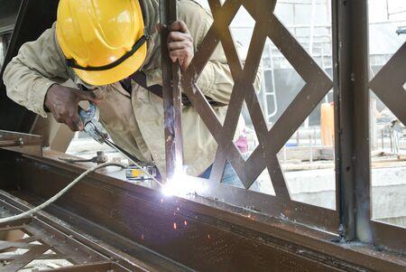 mild: Welders welded the decorative mild steel at the construction site