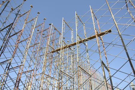 formwork: Scaffoldings erected to support building formwork and also function as the platform for construction workers standing.