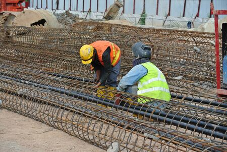 Construction workers fabricated bore pile reinforcement bar at the construction site.