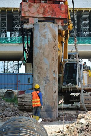 the casing: SELANGOR, MALAYSIA  MARCH, 2015: Bore pile steel casing install at the construction site in Malaysia. The steel casing use as a mould for the concrete pile. Editorial