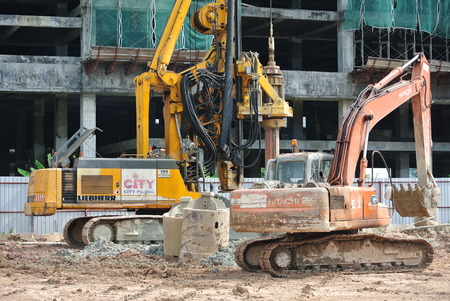 piling: SELANGOR, MALAYSIA  MARCH, 2015: Bore pile steel casing install at the construction site in Malaysia. The steel casing use as a mould for the concrete pile. Editorial