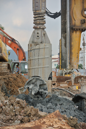 auger: SELANGOR, MALAYSIA  MARCH, 2015: Bore pile rig auger at the construction site in Malaysia. This heavy machine used during the foundation work. Editorial