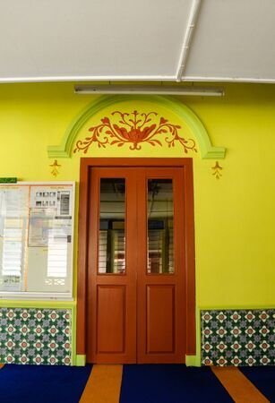 refurbish: Traditional timber door at  of Masjid Kariah Dato Undang Kamat. The moosque was built on 1934 and refurbish by local government on 1980. It is located in Jempol district, Negeri Sembilan, Malaysia.