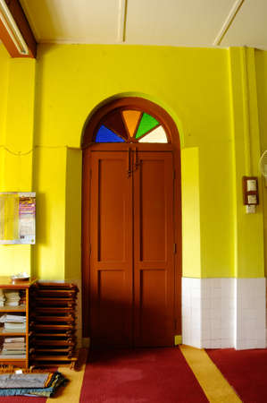 refurbish: Traditional wooden door at Masjid Kariah Dato Undang Kamat. The moosque was built on 1934 and refurbish by local government on 1980. It is located in Jempol district, Negeri Sembilan, Malaysia.