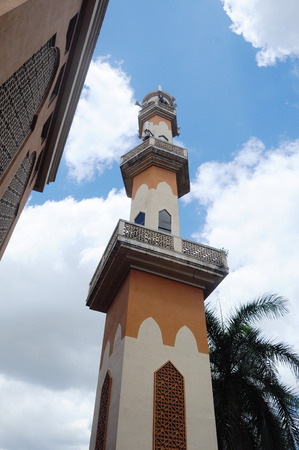 recite: KUALA LUMPUR, MALAYSIA  JANUARY, 2015: Minaret of the new mosque of Masjid Jamiul Ehsan at Setapak Kuala Lumpur, Malaysia The mosque was built on 1991 and replaced the old Mosque nearby function. .