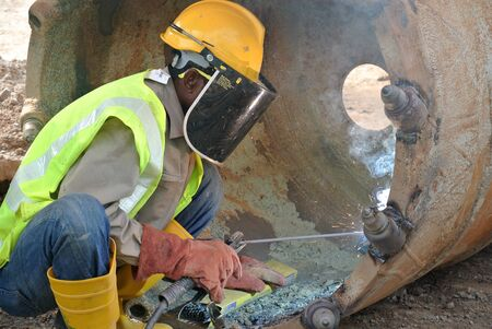auger: Licence welder weld bore pile auger at construction site in Malaysia on March 23, 2015 Editorial
