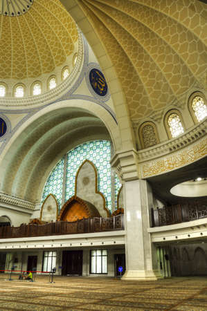 accommodate: Interior of The Federal Territory Mosque located at Kuala Lumpur, Malaysia on December 14, 2013. Open to public on 2000. The mosque can accommodate 17,000 worshippers at any one time.