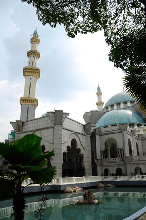 accommodate: The Federal Territory Mosque located at Kuala Lumpur, Malaysia on December 14, 2013. Open to public on 2000. The mosque can accommodate 17,000 worshippers at any one time.