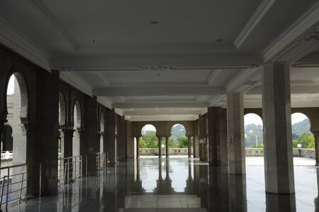 recite: Interior of The Federal Territory Mosque located at Kuala Lumpur, Malaysia on December 14, 2013. Open to public on 2000. The mosque can accommodate 17,000 worshippers at any one time.