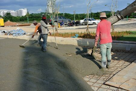 concrete form: CYBERJAYA, SELANGOR  AUGUST 22, 2014: The new liquid concrete is poured on top of the steel reinforcement bar to form a solid concrete slab when it has been hard.