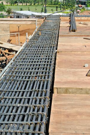 structural engineers: Steel reinforcement bars arranged and organized, before pouring the concrete and become part of the beam structure Stock Photo