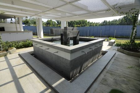 recite: SELANGOR, MALAYSIA  JUNE 15, 2015: Mosque Ablution. Ara Damansara Mosque is a modern design mosque on the green technology concept and was awarded with Green Building Index Gold Medal. It is located at the Ara Damansara residential area. Stock Photo