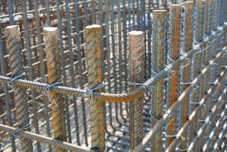 reinforce: Steel rods or steel reinforcement bars is the material used to reinforce concrete Stock Photo