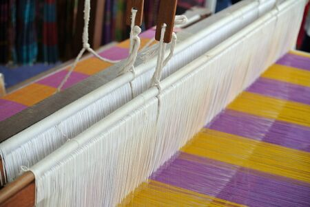 loom: A closeup image and detail of an old weaving loom Stock Photo