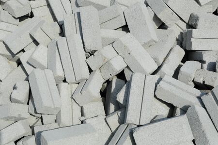 broken contract:  Group of white sand bricks on construction site in Selangor, Malaysia on May 16, 2015.