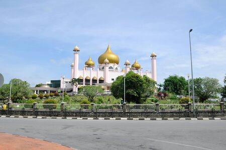 worshipper: SARAWAK, MALAYSIA  OCTOBER 21, 2014: The Kuching Town Mosque aka Masjid Bandaraya Kuching in Kuching Sarawak on October 21, 2014. The Mosque was opened to public on 1968 by King of Malaysia.