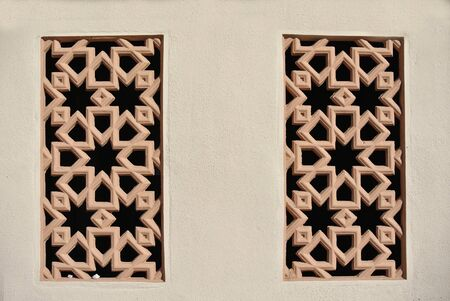precast: Decorative wall with Islamic geometry pattern made from precast fibre reinforce concrete. Stock Photo