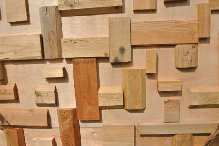cut and paste: Small pieces of wood cut and paste on the wall to form a pattern Stock Photo