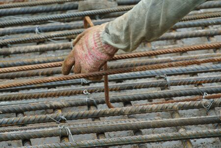 fabricating: MALACCA, MALAYSIA  SEPTEMBER 17, 2015: A construction workers fabricating floor slab reinforcement bar at the construction site in Malacca, Malaysia on September 17, 2015. Editorial