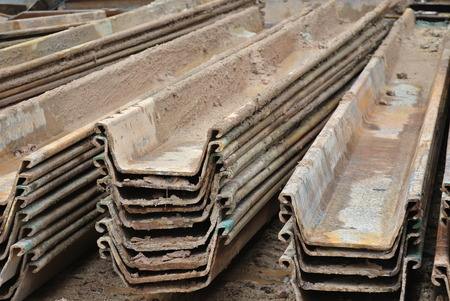 sheet pile: MALACCA, MALAYSIA  SEPTEMBER 15, 2015: Stack of retaining wall steel sheet pile cofferdam in the construction site in Malacca, Malaysia on September 15, 2015. Editorial