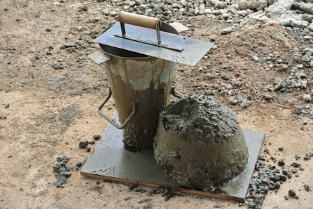 slump: MALACCA, MALAYSIA  SEPTEMBER 28, 2015: The slump test equipment at the construction site. Wet concrete was compacted in it.