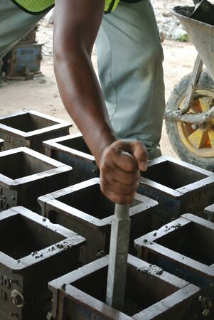 quality work: MALACCA, MALAYSIA  SEPTEMBER 28, 2015: Cube test. Mould of concrete for checking of concrete quality work or compression tests. Cube shape type. Editorial