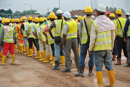SELANGOR, MALAYSIA  FEBRUARY13, 2015: Group of construction workers assemble at the open space.