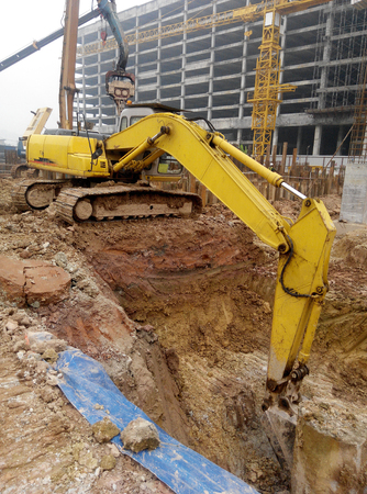 Excavators is heavy construction machine used to do soil excavation work at the construction. Powered by long hydraulic arm with basket.