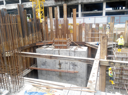 building foundation: SELANGOR, MALAYSIA – May 25, 2015: The concrete pile cap concreted at the construction site in Selangor Malaysia. The pile cap is the part of building foundation.