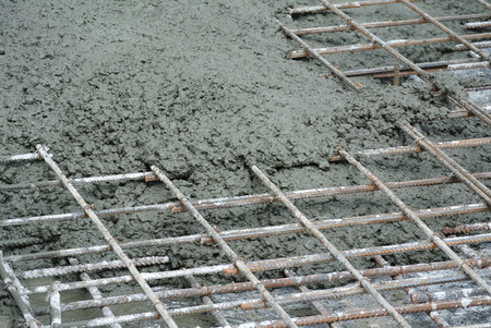 concrete form: SELANGOR, MALAYSIA -JULY 26, 2016: The wet concrete is poured on a steel reinforcement bar to form strong floor slabs called Reinforce Concrete Slab.