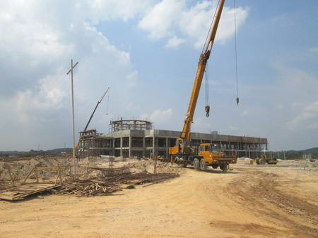 ongoing: MALACCA, MALAYSIA -JUNE 13, 2016: Construction site in progress at Malacca, Malaysia during daytime. Daily activity is ongoing.