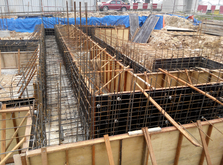 JOHOR, MALAYSIA -APRIL 06, 2016: Ground beam timber form work constructed by workers at the construction site.
