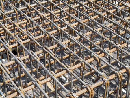 spacing: Hot rolled deformed steel bars or steel reinforcement bar at construction site.