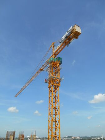 heavy risk: PERAK, MALAYSIA -JULY 27, 2016: Tower Crane used to lifting heavy load at construction site in Perak, Malaysia