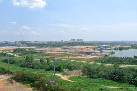 earthwork: CYBERJAYA, MALAYSIA -SEPTEMBER 10, 2013: Construction site at early stage during daytime. Some area earthwork still ongoing. Editorial