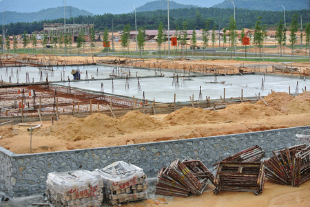 ongoing: CYBERJAYA, MALAYSIA -SEPTEMBER 10, 2013: Construction site at early stage during daytime. Some area earthwork still ongoing. Editorial