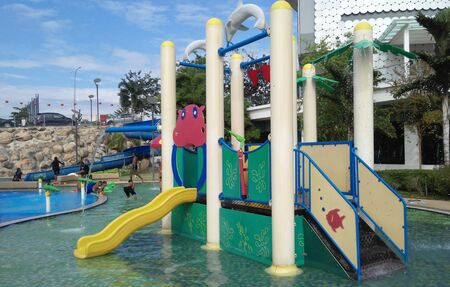 SEREMBAN, MALAYSIA -FEBRUARY 25, 2017: Modern children outdoor water  playground in the public water park at Seremban Malaysia. It was design with few different themes for kids to enjoy.
