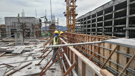 KUALA LUMPUR, MALAYSIA -JANUARY 15, 2017: Construction workers fabricating timber form work at the construction site. The form work was mainly made from timber and plywood. Editorial