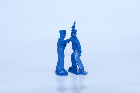 Blue color small size toy plastic soldiers isolated on white background.