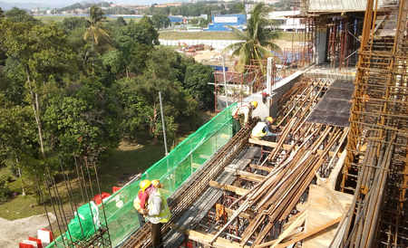 JOHOR, MALAYSIA -JANUARY 15, 2017: Construction workers fabricating timber form work at the construction site in Johor, Malaysia. The form work was mainly made from timber and plywood.