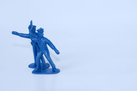plastic soldier: Blue color small size toy plastic soldiers isolated on white background.