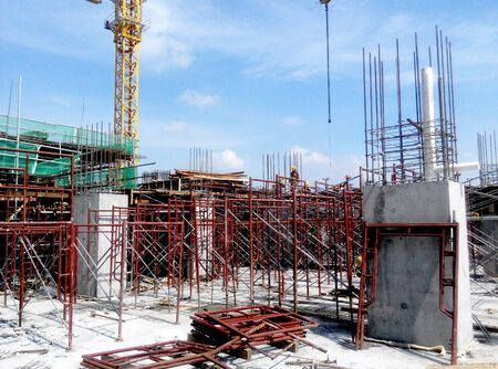 ongoing: Construction site in progress at Putrajaya, Malaysia during daytime. Daily activity is ongoing.