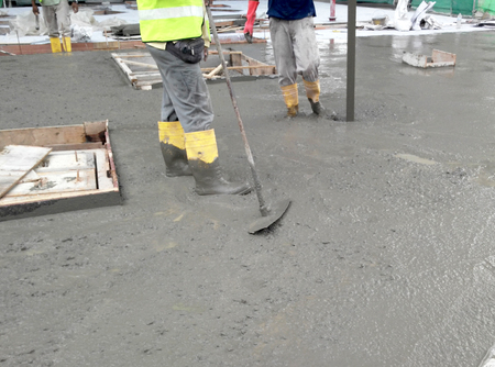 The wet concrete is poured on a steel reinforcement bar to form strong floor slabs called Reinforce Concrete Slab.
