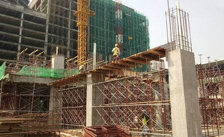 KUALA LUMPUR, MALAYSIA -JULY 15, 2017: Beam formwork fabricated by construction worker using plywood and timber at the construction site.