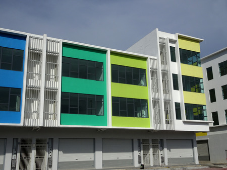 KUALA LUMPUR, MALAYSIA -DECEMBER 28, 2017: Two story shop lots with identical design and colorful facade.