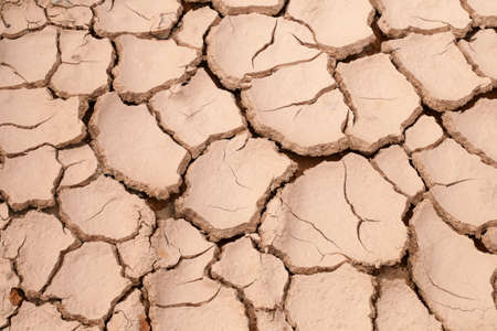 Mudlands that previously contained water have cracked due to hot weather and drought. All water content has been evaporated by the heat Foto de archivo