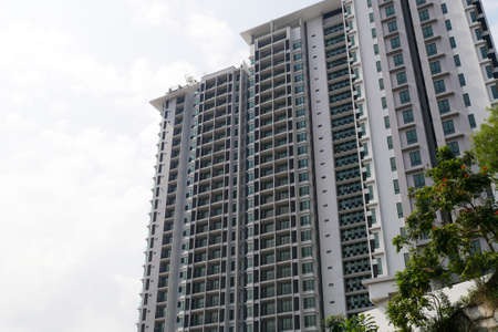 SELANGOR, MALAYSIA -JULY 22, 2020: High rise apartment building with modern facade design. Popular in the urban areas in Malaysia. Various facilities for the use of the residents are provided.