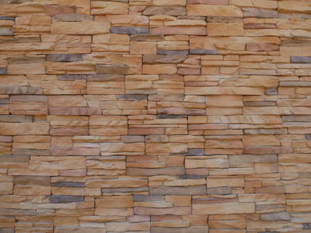 Slate brick in earth tone colour used as wall finishes. Installed overlap according to the method recommended by the manufacturer to get the maximum effect.