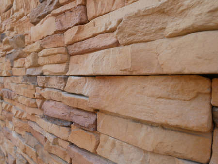 Slate brick in earth tone colour used as wall finishes. Installed overlap according to the method recommended by the manufacturer to get the maximum effect. Standard-Bild